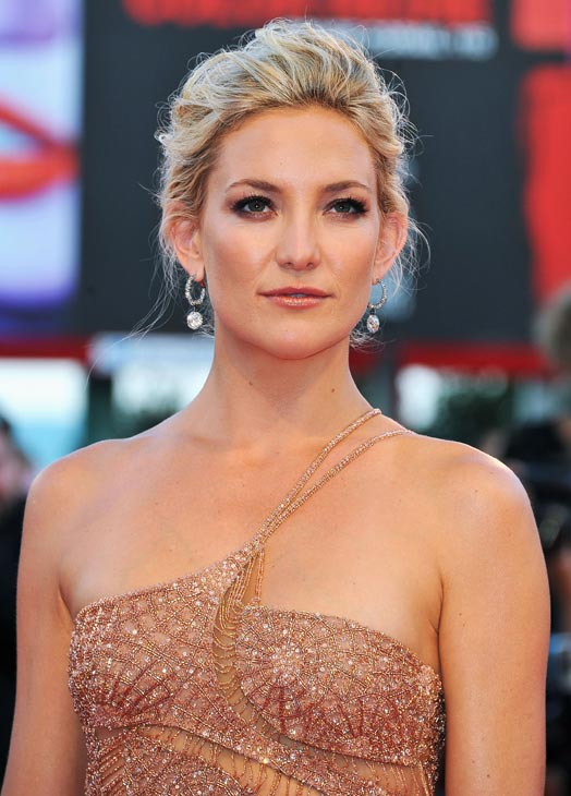 Kate Hudson, wearing an Atelier Versace gown and Faberge jewelry, attends 'The Reluctant Fundamentalist' premiere and opening ceremony during the 69th Venice International Film Festival at Palazzo del Cinema on August 29, 2012 in Venice, Italy.