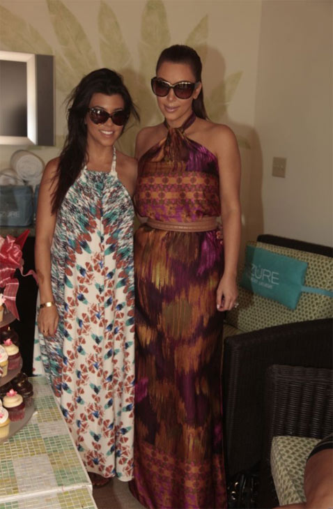 Kim Kardashian and her sister Kourtney appear at her bachelorette celebration at the Palazzo Pool in Las Vegas on Sunday, July 24, 2011.
