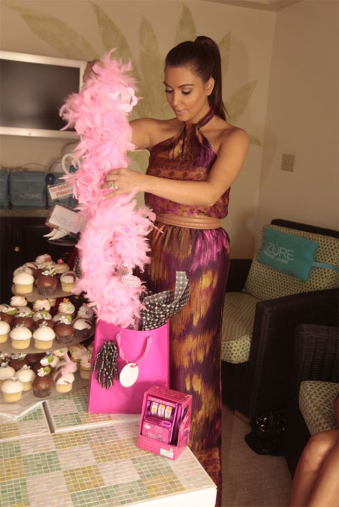 Kim Kardashian appears with gift bags and a 3-foot cupcake tree from The Palazzo&#39;s Sweet Surrender boutique as she celebrates her bachelorette weekend on July 24, 2011 at The Palazzo. <span class=meta>(ISPhotography &#47; imagesofvegas.com &#47; Palazzo Pool)</span>