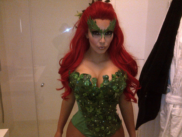 Kim Kardashian revealed her Poison Ivy costume in a photo posted on her official Twitter page on October 29, 2011. The Batman villain was portrayed by Uma Thurman in the 1997 film &#39;Batman and Robin.&#39; <span class=meta>(Twitpic.com&#47;77w0db)</span>