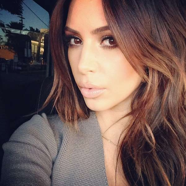 Kim Kardashian appears in a February 2014 Instagram photo, sporting newly-dyed brunette hair.