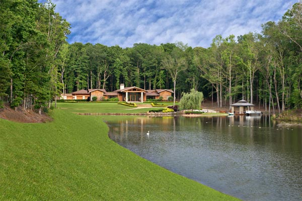 An exterior shot of Kenny Rogers' former Polynesian-inspired lake house in Nicholson, Georgia. The singer had designed the 5-bedroom estate, which he once compared to Disneyland, and sold it on June 27, 2012 for $2.25 million.