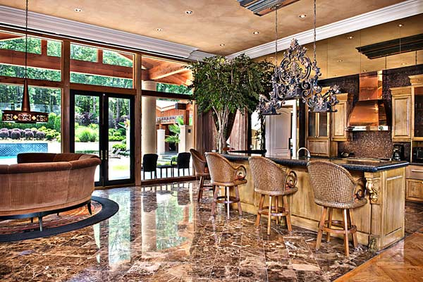 A kitchen inside Kenny Rogers&#39; former Polynesian-inspired lake house in Nicholson, Georgia. The singer had designed the 5-bedroom estate, which he once compared to Disneyland, and sold it on June 27, 2012 for &#36;2.25 million. <span class=meta>(GrandEstatesAuction.com)</span>