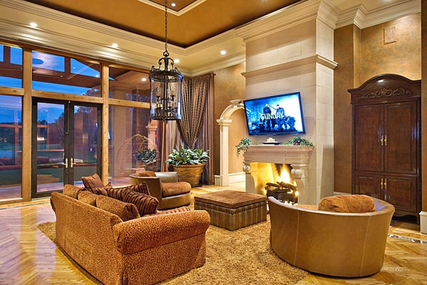 A living room inside Kenny Rogers' former Polynesian-inspired lake house in Nicholson, Georgia. The singer had designed the 5-bedroom estate, which he once compared to Disneyland, and sold it on June 27, 2012 for $2.25 million.