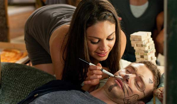 Mila Kunis appears with co-star Justin Timberlake in a scene from the 2011 film 'Friends with Benefits.'
