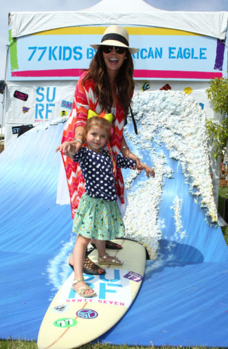 "<div class=""meta ""><span class=""caption-text "">Ali Landry and her daughter Estela, whose father is the actress' husband,  film director Alejandro Gomez Monteverde, appear at the 'Surfin' Safari-themed 77kids by American Eagle Denim Decorating Booth at the 22nd annual Elizabeth Glaser Pediatric Aids Foundation 'A Time For Heroes' Celebrity Picnic. The event was held at Wadsworth Great Lawn in the Brentwood area of Los Angeles, California on Sunday, June 22, 2011. (WireImage / Shadow PR)</span></div>"