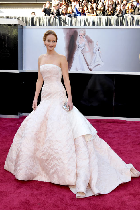 Actress Jennifer Lawrence arrives at the 85th Academy Awards at the Dolby Theatre on Sunday Feb. 24, 2013, in Los Angeles. The best-acress nominee wore a pale pink strapless Dior gown to the event. <span class=meta>(AP Photo&#47;John Shearer&#47;Invision)</span>
