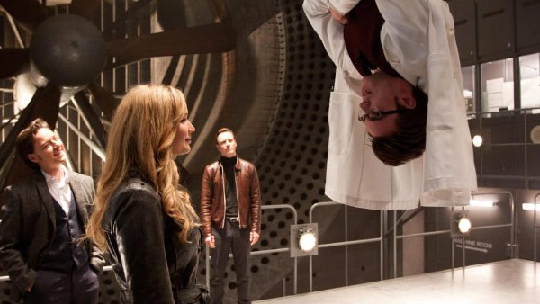 Jennifer Lawrence and Nicholas Hoult appear in a scene from their 2011 film 'X-Men: First Class.' Hoult is hanging upside down.