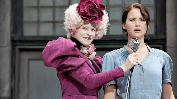 Jennifer Lawrence appears in a scene from the 2012 film 'The Hunger Games.' She stands alongside Elizabeth Banks who plays Effie Trinket in the film.
