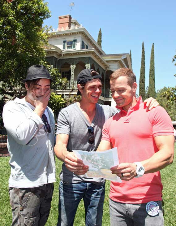 Joey Lawrence &#40;right&#41; celebrated his 36th birthday on April 20, 2012. His his wife surprised him with a trip to Disneyland in Anaheim, California, and his two brothers came along, Matthew &#40;middle&#41; and Andy &#40;left&#41;.  The three Lawrence men posed next to the Haunted Mansion at the same spot they were photographed together in 1995 during a Disneyland Halloween celebration. They are holding that picture in their hands. Joey Lawrence said  his brother Andy looked like a baby Dracula.  <span class=meta>(Paul Hiffmeyer &#47; Disneyland)</span>