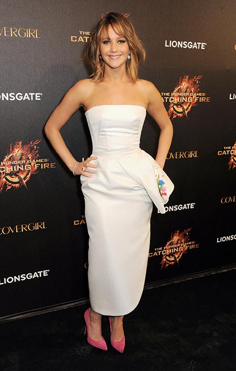 "<div class=""meta image-caption""><div class=""origin-logo origin-image ""><span></span></div><span class=""caption-text"">Jennifer Lawrence arrives on the red carpet at Lionsgate's 'The Hunger Games: Catching Fire' Cannes Party at Baoli Beach, sponsored by COVERGIRL, on May 18, 2013 in Cannes, France. (Dave M. Benett / Getty Images for Lionsgate)</span></div>"