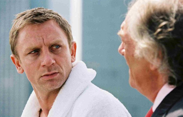 "<div class=""meta ""><span class=""caption-text "">The 2004 movie 'Layer Cake,' which starred Daniel Craig as a charismatic coke dealer, caught the eye of James Bond film producers who were looking to replace Pierce Brosnan. According to the UK newspaper The Telegraph, in October of 2008, Craig initially was not enthusiastic about taking on the role because there hadn't been a script yet and he couldn't say yes without a script. Brosnan helped get Craig on board, telling him to 'go for it' and that he will have the ride of his life.(Pictured: Daniel Craig and Michael Gambon appear in a scene from the 2004 film 'Layer Cake.') (Sony Pictures Classic)</span></div>"