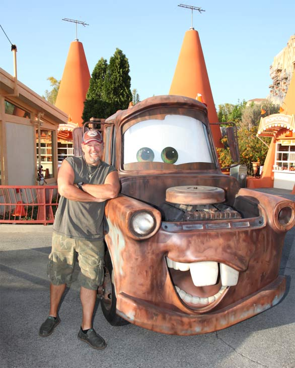 Larry the Cable Guy (actor Dan Whitney) meets his alter ego, Mater, while getting a preview of Cars Land in Disney California Adventure park in Anaheim, California on May 31, 2012.