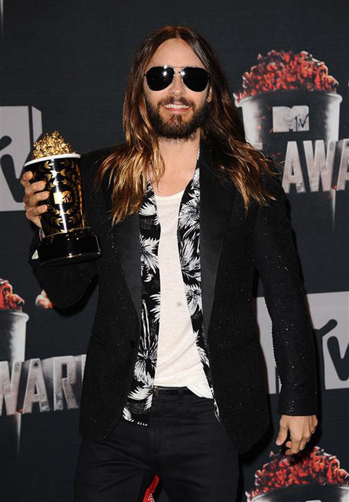 Jared Leto poses with his award for Best On-Screen Transformation for his role as transgender HIV-positive patient Rayon in the 2013 movie &#39;Dallas Buyers Club,&#39; for which he also won his first Oscar, at the 2014 MTV Movie Awards at the Nokia Theatre in Los Angeles on April 13, 2014. <span class=meta>(Lionel Hahn &#47; AbacaUSA &#47; Startraksphoto.com)</span>