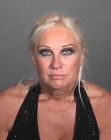 Linda Hogan appears in a booking photo after...