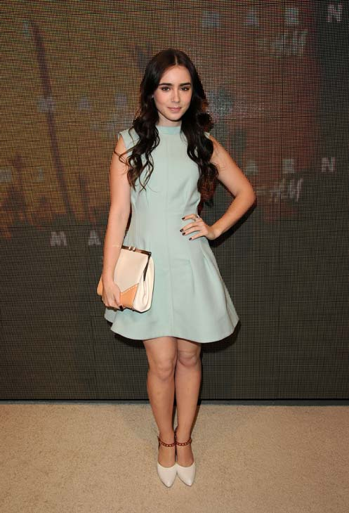 Lily Collins, Phil Collin&#39;s daughter and Julia Roberts&#39; co-star in the 2012 movie &#39;Mirror, Mirror,&#39; appears at the launch party for H and M&#39;s Marni collection in Los Angeles on Feb. 17, 2012. She is wearing an outfit from the fashion line. <span class=meta>(H and M &#47; Marni)</span>