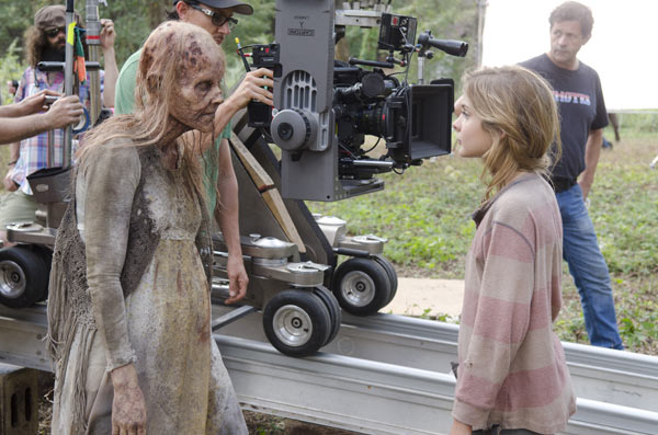Brighton Sharbino &#40;Lizzie&#41; appears with a woman dressed as a Walker on the set of AMC&#39;s &#39;The Walking Dead&#39; episode 14, &#39;The Grove,&#39; which aired on March 16, 2014. <span class=meta>(Gene Page &#47; AMC)</span>