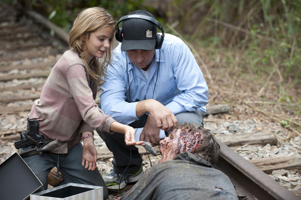 Brighton Sharbino &#40;Lizzie&#41; appears with a crew member and a man dressed as a Walker on the set of AMC&#39;s &#39;The Walking Dead&#39; episode 14, &#39;The Grove,&#39; which aired on March 16, 2014. <span class=meta>(Gene Page &#47; AMC)</span>