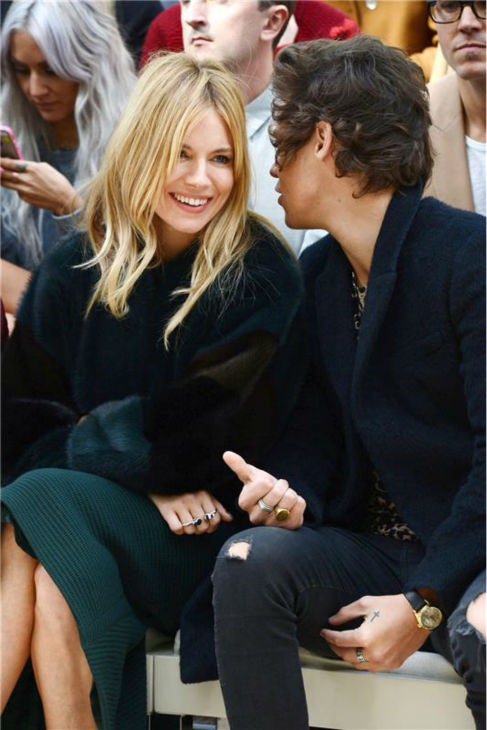 "<div class=""meta ""><span class=""caption-text "">One Direction singer Harry Styles watches the Burberry Prorsum Spring / Summer 2014 fashion show with Sienna Miller during London Fashion Week fashion show on Sept. 16, 2013. (Richard Young / Rex / Startraksphoto.com)</span></div>"