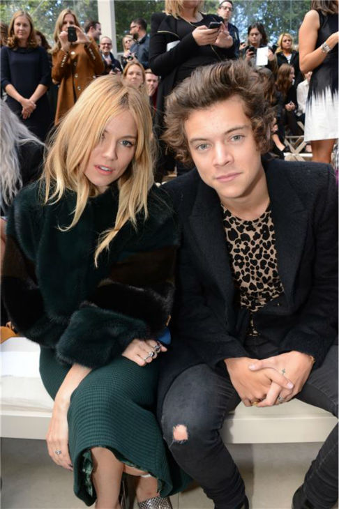 One Direction singer Harry Styles watches the Burberry Prorsum Spring &#47; Summer 2014 fashion show with Sienna Miller during London Fashion Week fashion show on Sept. 16, 2013. <span class=meta>(Richard Young &#47; Rex &#47; Startraksphoto.com)</span>
