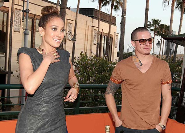 Jennifer Lopez and boyfriend Casper Smart attend the grand opening of restaurant Planet Dailies and lounge Mixology 101 in Los Angeles on April 5, 2012. The event included a screening of the 'American