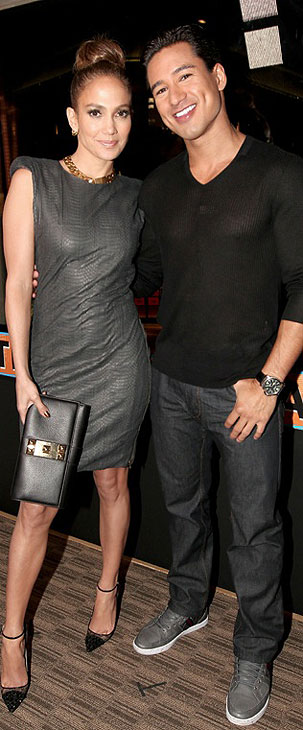 Jennifer Lopez and TV personality Mario Lopez attend the grand opening of restaurant Planet Dailies and its cocktail lounge Mixology 101 in Los Angeles on April 5, 2012. The event included a screening of the &#39;American Idol&#39; judge&#39;s new music video, &#39;Dance Again,&#39; which features her boyfriend Casper Smart. <span class=meta>(Christopher Polk &#47; Getty Images)</span>