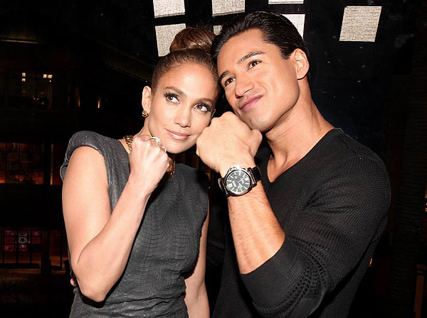 Jennifer Lopez and TV personality Mario Lopez attend the grand opening of restaurant Planet Dailies and its cocktail lounge Mixology 101 in Los Angeles on April 5, 2012.
