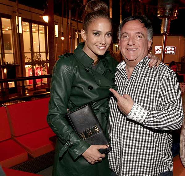 Jennifer Lopez and Robert Earl attend the grand opening of his restaurant Planet Dailies and its cocktail lounge Mixology 101 in Los Angeles on April 5, 2012.