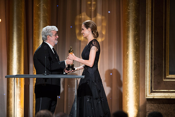 Oscar-nominated writer&#47;director&#47;producer George Lucas &#40;left&#41; presents the Jean Hersholt Humanitarian Award to Angelina Jolie during the 2013 Governors Awards at The Ray Dolby Ballroom at Hollywood and Highland Center in Hollywood, California on Saturday, Nov. 16, 2013. She gave an emotional speech honoring her late mother. <span class=meta>(Todd Wawrychuk &#47; A.M.P.A.S.)</span>