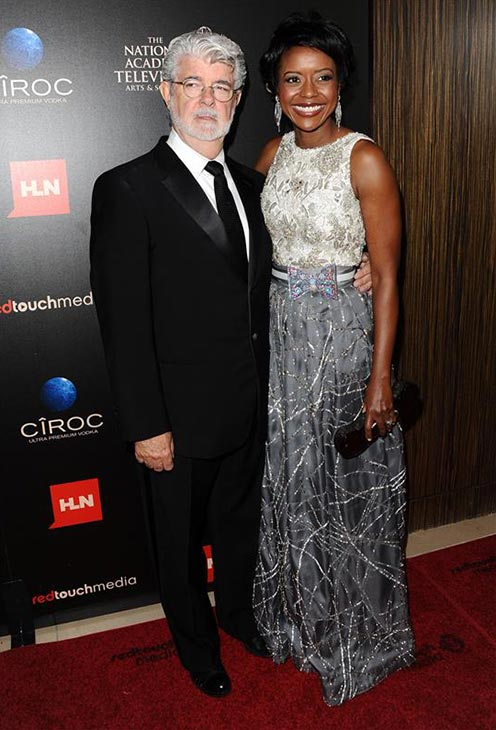 &#39;Star Wars&#39; creator George Lucas and wife Mellody Hobson welcomed a baby girl, Everest, via a surrogate mother on Aug. 9, 2013. It is Lucas&#39; fourth child -- he has three adult adopted children. He and Hobson wed on June 22.  &#40;Pictured: George Lucas and then-fiance Mellody Hobson attend the 40th annual Daytime Emmy Awards in Beverly Hills, California on June 16, 2013.&#41; <span class=meta>(Sara De Boer &#47; startraksphoto.com)</span>