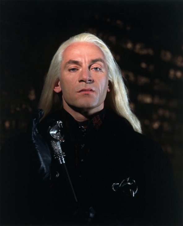 Lucius Malfoy (Jason Isaacs) appears in a scene...