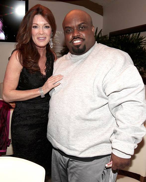 Singer Cee Lo Green of NBC's 'The Voice' and Lisa Vanderpump attend the grand opening of restaurant Planet Dailies and lounge Mixology 101 in Los Angeles on April 5, 2012.