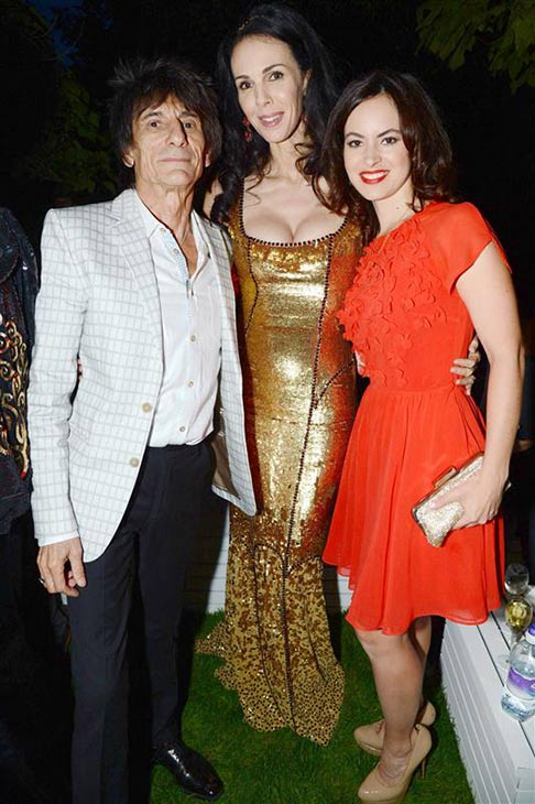 "<div class=""meta image-caption""><div class=""origin-logo origin-image ""><span></span></div><span class=""caption-text"">L'Wren Scott appears with partner Mick Jagger's Rolling Stone's band mate Ronnie Wood and his wife Sally Humphreys at the 2013 Serpentine Summer Party at the Serpentine Pavillion in London on June 26, 2013. (Richard Young / Rex / Startraksphoto.com)</span></div>"