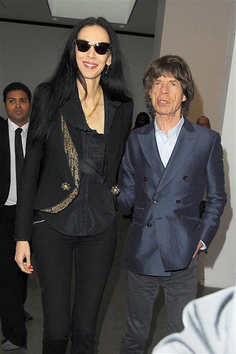 L&#39;Wren Scott appears with Mick Jagger during 2013 London Fashion Week at Balthazar in London on Sept. 15, 2013. <span class=meta>(Richard Young &#47; Rex &#47; Startraksphoto.com)</span>