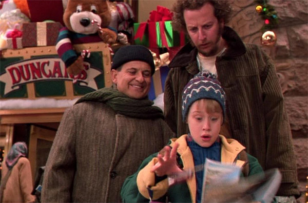 Macaulay Culkin appears with Joe Pesci (left) and Daniel Stern (right) in a scene from the 1991 film 'Home Alone 2: Lost in New York.'