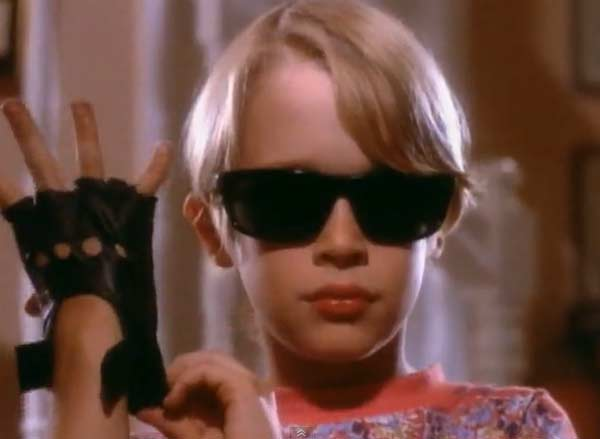 Macaulay Culkin appears in Michael Jackson&#39;s video &#39;Black or White,&#39; released in 1991. Culkin&#39;s character appears as a young boy whose father is angry with him for playing such loud music, and his father angrily asks him to turn it down. Culkin&#39;s character retaliates by bringing speakers into the living area, and blasting music so loud his father is famously launched half way across the planet in his chair. Culkin is known for his role in the &#39;Home Alone&#39; movies and other films such as &#39;Richie Rich&#39; and &#39;Saved!&#39; <span class=meta>(Epic Records)</span>