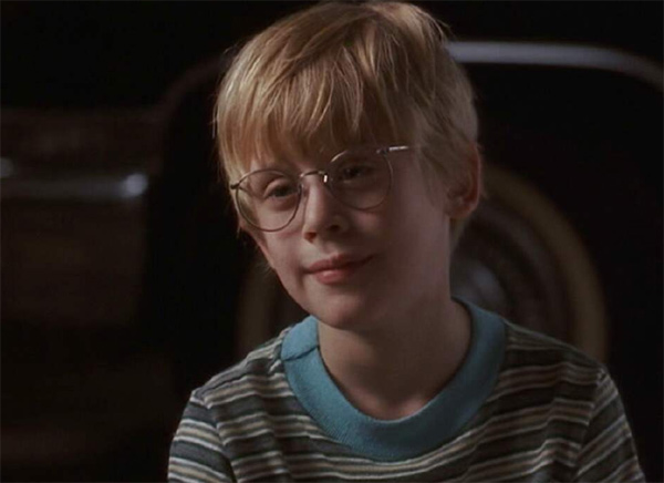 Macaulay Culkin appears in a scene from the 1991 movie 'My Girl.' He played Thomas, the best friend and love interest of a young girl named Vada, portrayed by Anna Chlumsky. This coming-of-age film also stars Dan Aykroyd and Jamie Lee Curtis.