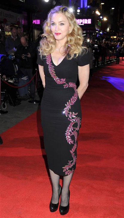 "<div class=""meta image-caption""><div class=""origin-logo origin-image ""><span></span></div><span class=""caption-text"">Madonna wears a L'Wren Scott dress at the premiere of 'W.E' in London on Oct. 23, 2011. (Richard Young / Rex / Startraksphoto.com)</span></div>"