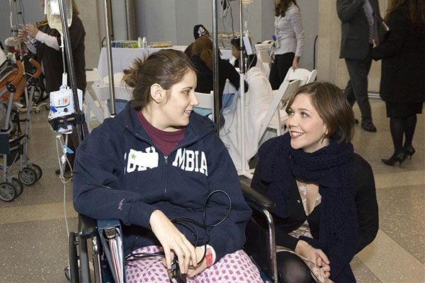 Maggie Gyllenhaal ('The Dark Knight') visits a patient at New York Presbyterian Hospital as part of the Duracell Power A Smile Campaign on Dec. 3, 2008.