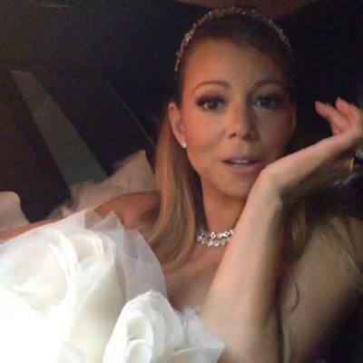 Mariah Carey, wearing wedding attire, rides in a vehicle to her wedding vow renewal ceremony to husband Nick Cannon at Disneyland on April 30, 2013, as seen in a Vine video she posted. Accompanied by Monroe and twin son Moroccan, Carey and Cannon renewed their vows that day to celebrate their fifth anniversary. They also celebrated the children&#39;s second birthday.  &#39;Slowly making our way to the freezing cold guests #donthatemebecauseimasiva #cinderella,&#39; Carey Tweeted. <span class=meta>(vine.co&#47;v&#47;bQBYb19lWpQ)</span>