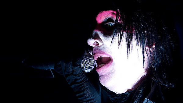 Marilyn Manson appears in a photo performing...