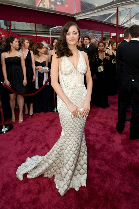 Marion Cotillard arrives at the 80th Annual Academy Awards at the Kodak Theatre in Hollywood, Calif. on Sunday, Feb. 24, 2008. The actress dazzled in a white and silver Jean Paul Gaultier dress which she paired with long gold chains and her wavy locks down. The 2013 Oscar ceremony is scheduled to air February 24 on ABC. <span class=meta>(Armando Flores &#47; A.M.P.A.S.)</span>