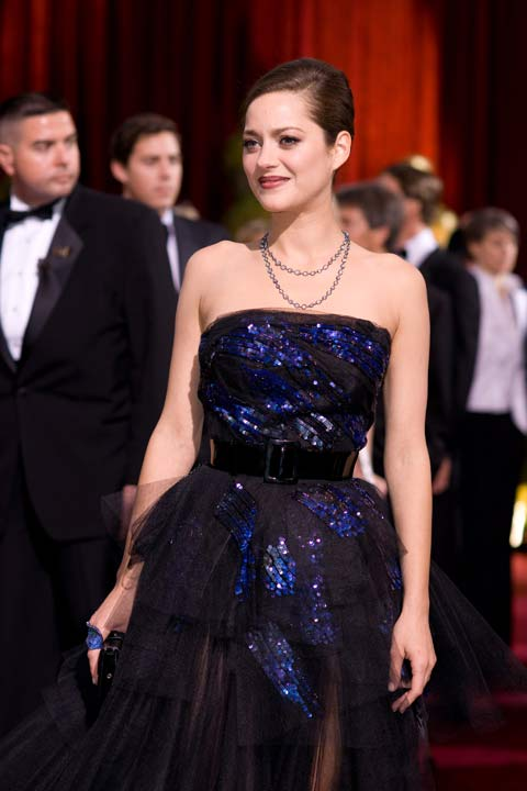 Marion Cotillard attends the 81st Annual Academy Awards at the Kodak Theatre in Hollywood, Calif. on Sunday, Feb. 22, 2009. The actress turned heads in a floor-length black and blue Christian Dior Couture dress which featured sequins and sheer patterns. The &#39;Inception&#39; actress completed her look with a black clutch and a silver necklace.  The 2013 Oscar ceremony is scheduled to air February 24 on ABC. <span class=meta>(John Didier &#47; A.M.P.A.S.)</span>