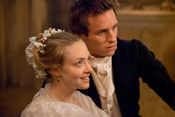Amanda Seyfried and Eddie Redmayne appear as Cosette and M