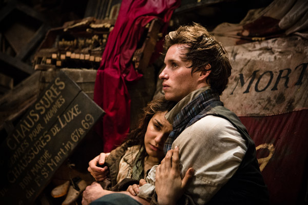 Samantha Barks and Eddie Redmayne appear as Eponine and Marius in a sce