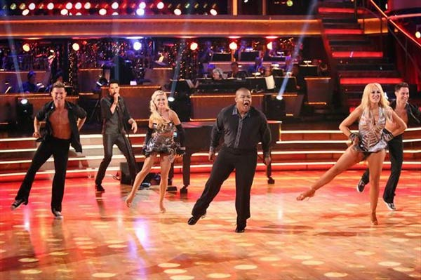 "<div class=""meta ""><span class=""caption-text "">Musician Frankie Moreno performed on 'Dancing With The Stars: The Results Show' on Tuesday, Oct. 9, 2012, with a medley of 'Tangerine Honey' and 'Real Wild Child,' accompanied by Troupe members Lacey Schwimmer and Kyle Massey. (ABC Photo)</span></div>"