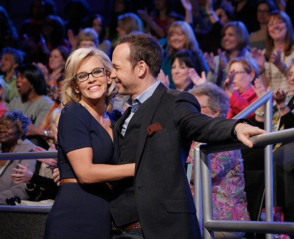 Jenny McCarthy, wearing a yellow sapphire engagement ring, embraces fiance Donnie Wahlberg on ABC&#39;s &#39;The View&#39; on April 16, 2014. McCarthy, a co-host on the show, announced their engagement that morning. <span class=meta>(ABC Photo &#47; Heidi Gutman)</span>