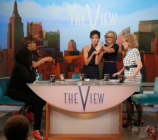 Jenny McCarthy, wearing a yellow sapphire engagement ring, gets embraced by co-host Barbara Walters on ABC&#39;s &#39;The View&#39; on April 16, 2014. McCarthy, a co-host on the show, announced her engagement to Donnie Wahlberg. Also pictured: Co-hosts Whoopi Goldberg, Sherri Shepherd and Barbara Walters and guest co-host Sage Steele. <span class=meta>(ABC Photo &#47; Heidi Gutman)</span>