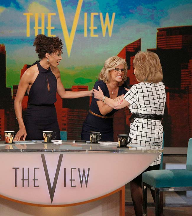 Jenny McCarthy, wearing a yellow sapphire engagement ring, gets embraced by co-host Barbara Walters on ABC&#39;s &#39;The View&#39; on April 16, 2014. McCarthy, a co-host on the show, announced her engagement to Donnie Wahlberg. Also pictured: Guest co-host Sage Steele. <span class=meta>(ABC Photo &#47; Heidi Gutman)</span>