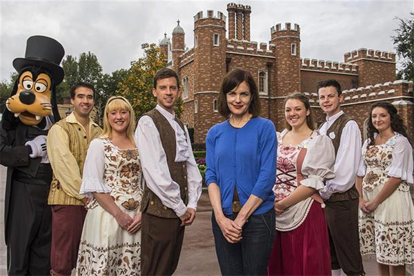 Elizabeth McGovern, who plays  Cora Crawley, Countess of Grantham, on the show 'Downton Abbey,' (center) poses with Goofy and Disney employees at Walt Disney World in Florida on Dec. 29, 2013 in a recreation of the series' cast photo.